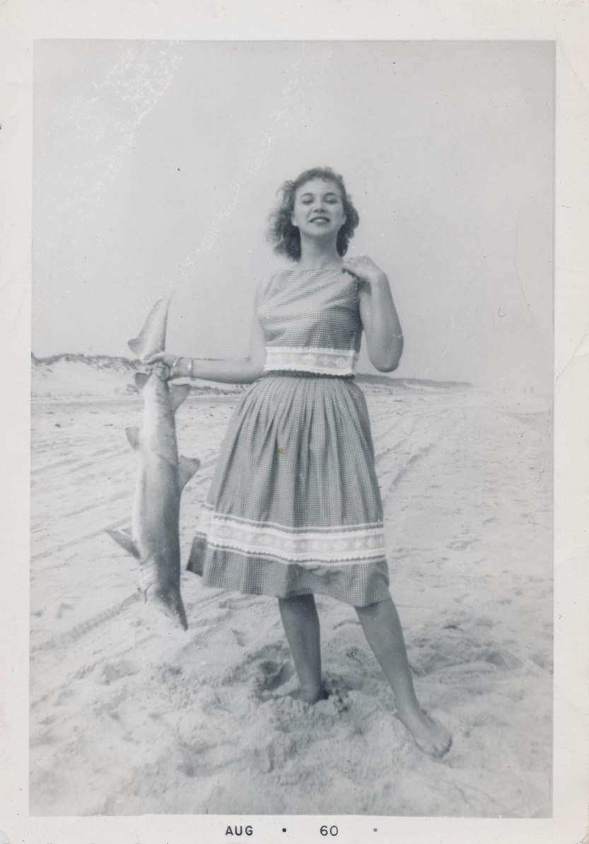 Woman shows off her shark catch